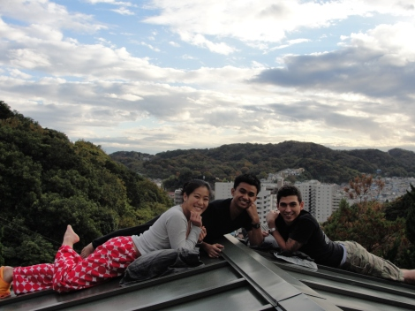 Room mates hanging out on the roof in Japan